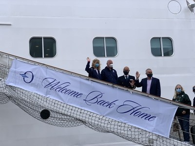 """Today in Copenhagen, guests boarded Oceania Cruises' Marina for the first time in 524 days. The sign on the gangway, here with the first guests to embark read, """"Welcome Back Home."""""""