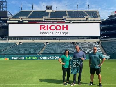 Celebrating their expanded partnership are left to right: Catherine Carlson, SVP, Revenue & Strategy, Philadelphia Eagles, Carsten Bruhn, President & CEO, Ricoh North America and Frank Gumienny, SVP, CFO, Philadelphia Eagles.